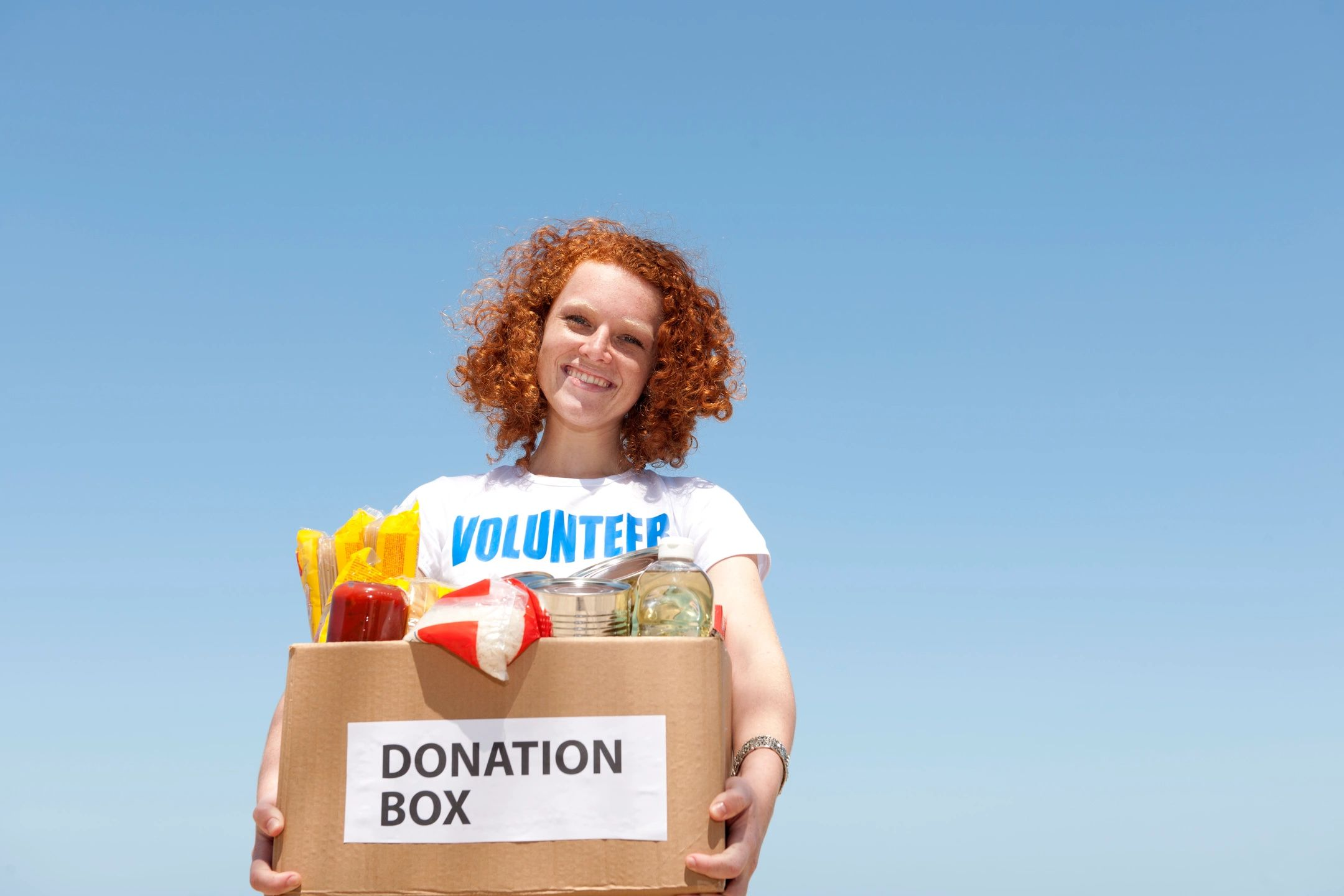 volunteer holding donation box